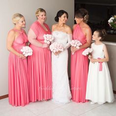 Swooning over beautiful bride Sarah in her stunning dress and her bridal party in the Goddess By Nature signature multiway ballgowns in the amazing Coral Kiss colour which looks amazing on her girls!  we also adore the matching Flowergirl sash and gorgeous pastel pink bouquets  www.goddessbynature.com Stockists worldwide of our award winning Australian made collections  #goddessbynature #goddessbynaturebridesmaids #multiwaydress #ballgown #bride #bridesmaidsdress #bridesmaidsdresses