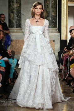 Emilio Pucci Spring Summer 2011 White Long Sleeve Ruffle Lace Wedding Gown. #KellyIrwinRutty is the the Head of #Production #PrestonBailey #Designs (www.prestonbailey...). She has helped to #Plan, #Design and #Execute some of the most #Lavish #Weddings and #Events in the world for a clientele that includes A-list #Celebrities #Athletes and #CEO's. Here she shares a bit of her #Inspiration. @KellyIrwinDesigns