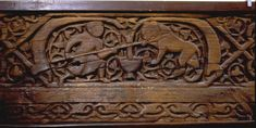 Fatimid wooden plank with carved lion hunt, 11th century