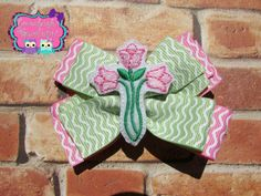 A personal favorite from my Etsy shop https://www.etsy.com/listing/231626135/pink-and-green-pinwheel-hair-bow-felt
