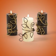 "2"" Pillar candles: (any color)  •12 gauge Aluminum floral wire: gold, brown  •Round-nose pliers  •Needle-nose pliers  •Wire cutters"