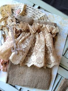 Lace and Burlap! It would be neat to make curtains out of this!!