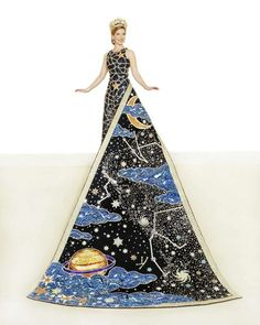 Catherine Elizabeth Frank, Duchess of Celestial Wonders. This gown's solid-sequin, navy blue celestial pattern is decorated in silver-set crystal rhinestones. Densely beaded gold crystal stars are scattered throughout. The navy blue velvet train is jeweled with hundreds of Lochrosen crystals and stars in silver aquamarine and violet bicone crystals. She is the daughter of Mr. and Mrs. Edwin Hemy Frank III.