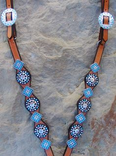 Med. oil western breast collar, created with real poker chips, and card suit conchos. Accented with turquoise and clear glass crystals.