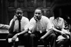 May 21-22,1961: Rev. Ralph Abernathy and Rev. Martin Luther King during stand-off with white mob outside Abernathy's Baptist Church in Montgomery, Alabama King had been on the phone with Attorney General Robert Kennedy seeking help. Photo:Paul Schutzer.