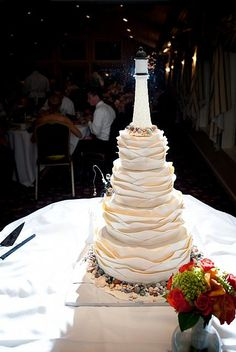 different look - NO lighthouse and natural stones at bottom but like the natural drama of this cake (dont know if maddie would like)