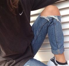 sporty outfit and torn jeans