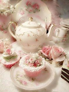 Pretty teapot with scattered roses