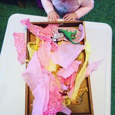Tissue paper tray, 20 activities for 12-18 months old, 20 play ideas for toddlers, activities for one year old, montessori activities for a toddler, development promoting activities for toddlers, activities for 13 month old, activities for 14 month old, activities for 15 month old, activities for 16 month old, activities for 17 month old, activities for 18 month old, activities for a toddler, activities for one year olds, activities for two year olds