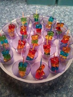 Drunken gummy bears- these were soaked in Smirnoff Whipped Vodka for 3 days. The… Drunken gummy bears- these were soaked in Smirnoff Whipped Vodka for 3 days. The bears will get bigger and softer as they soak up the vodka. Candy Drinks, Fun Drinks, Yummy Drinks, Beverages, Cocktail Recipes For A Crowd, Food For A Crowd, St Patrick's Day Cocktails, Cocktail Drinks, New Years Cocktails