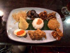 Nasi nenek moyang  A dish that serves 3 type of different rice , which is :  Nasi lemak , nasi goreng , nasi kuning