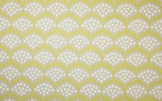 Pollen Wallpaper A contemporary floral patterned wallpaper printed in mimosa and grey with cream spots.