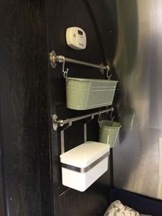 Ikea hanging system for bathroom storage in RV