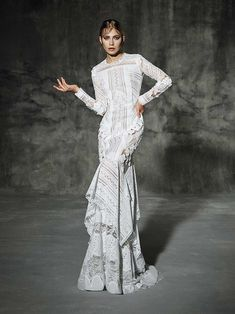 Rocafort from Yoaln Cris  wedding dresses 2016 -Pure white long sleeved wedding dress made by mixing macramé laces and white silk flowers. An orginal and very modern wedding dress. -  see the rest of the collection on www.onefabday.com
