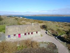 Barrderry, Carraroe, Co. Galway, a detached house for sale with 2 bedrooms and 1 bathroom at around on Property. Walk In Shower Cubicles, Ocean Properties, Stairs In Living Room, Wash Hand Basin, Septic Tank, Formal Gardens, Small Patio, Stunning View, Concrete Floors
