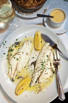 This simple red snapper preparation steams the fish with white wine, lemon, and fresh herbs, trapping the delicious juices and keeping the fish moist.