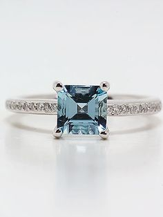 Emerald cut aquamarine engagement ring... this is pretty from the top, but the side view is too busy