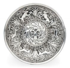 A GEORGIAN SILVER REPOUSSÉ BOWL   CAUCASUS, 18TH/19TH CENTURY   Of rounded form with convex centre, rimless, the cavetto with foxes, rabbits and birds amidst foliage, the centre with crowned two-headed eagle holding globe and sword, haircrack to the lip otherwise in good condition
