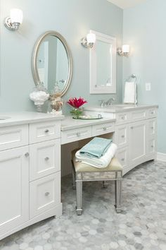 Simple bathroom design with white vanity & classic marble hex tile