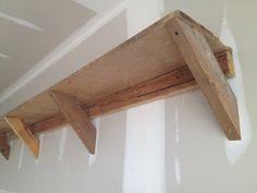Easy DIY garage shelving from reclaimed barn wood.   Don't worry. Be happy. Keep learning.