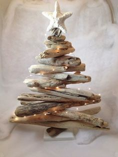 i'm not a big fan of christmas -- too much commercialism, too much stuff -- but a driftwood tree is pretty darn cool (like this one from c...