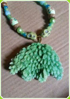 Check out this item in my Etsy shop https://www.etsy.com/uk/listing/286838111/unusual-green-coral-stone-necklace