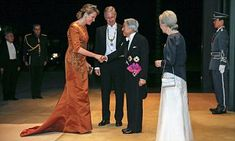 Queen Mathilde and King Phillippe, 56, of Belgium attended a Japanese state dinner in Tokyo on Tuesday evening on their second day of their tour of Japan that marks 150 years of ties between the two countries.