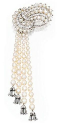 PLATINUM, CULTURED PEARL AND DIAMOND TASSEL CLIP-BROOCH, VAN CLEEF & ARPELS The stylized bow supporting a fringe accented by diamond tassels, set throughout with cultured pearls measuring approximately 7.4 to 2.9 mm, accented by round, baguette and single-cut diamonds weighing approximately 6.50 carats, signed Van Cleef & Arpels, numbered N.Y. 14437; circa 1950.
