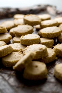"""NYT Cooking: Flavored with sesame seeds and tahini paste, these sophisticated shortbread cookies, adapted from """"Soframiz"""" by Ana Sortun and Maura Kilpatrick, have a pleasing crumbly texture and an intense, almost nutty flavor. Serve them as part of a cookie plate for dessert, or with coffee or tea as a midafternoon snack."""
