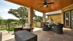 Your #covered #outdoor #patio makes entertaining effortless with a built-in #bar and #grill, spacious seating area, and #stairway down to the manicured #backyard. #outdoor #entertainment #ideas
