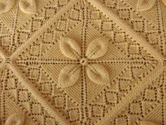 MARIETTE'S BACK TO BASICS: {Mom's Hand Knitted Bedspread as Window Display}  Looking for this pattern if anyone sees it! Thanks. :)