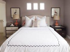 Henry Walker Crestpointe Model Home. Interior Design by Alice Lane Home Collection.   (bedroom, coral, orange, artwork, nightstand, pillows)