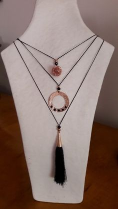 Set of rose gold and black necklaces