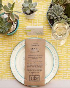 Paper envelope menus feature a casual stamp motif that can be carried out in other stationery elements