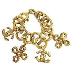 Pre-Owned Chanel #8295 Cc Gold Multi Charm Textured Bracelet ($396) ❤ liked on Polyvore featuring jewelry, bracelets, gold jewelry, chanel jewellery, chanel, gold bangles and yellow gold jewelry