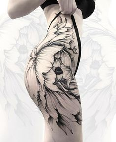 Just found this beautiful sexy floral thigh tattoo on this sexy woman. I always would say that women with pale skin would look so beautiful with black and gray tattoos.