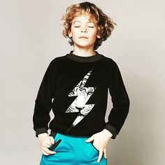 """Day dreamin Pline. Here he's wearing the """"Tiger Bolt"""" sweater and """"Pharell"""" pants. #milkontherocks #paris #children #kidsfashion #kids #tiger #sweater by milkontherocksnyc"""
