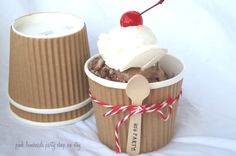 Wedding ice cream cup and wooden spoon tied together.