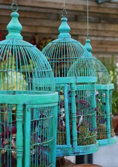 turquoise bird cages--I should paint mine and hang it from the tree in the backyard with candles in mason jars. That would be cool.