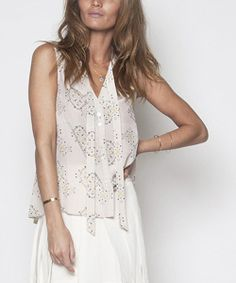 Airy, luxurious silk shapes this top! Tailored for feminine elegance, this top features a tie detail at the neck for a very pretty touch.