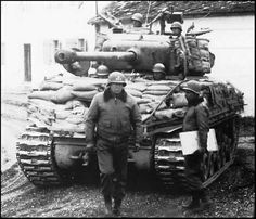 George Patton in front of an M4A3E8 Sherman of the 14th Armored Division