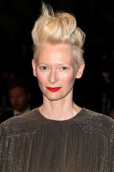 Never the wallflower, Tilda Swinton brought her own brand of brash style to Cannes with this platinum, skyscraper-high crop and foxy red lippy. Punk rock!