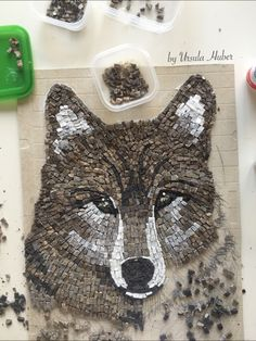 Marble wolf mosaic by Ursula Huber