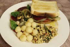 'Chicken' sandwich with potato puffs and scrambled tofu --#vegan #vegetarian #chicken #mockmeat #easydinner #chickensandwich #beetroot #onion #tomato #babyspinach #mushroom #tofu #tofuscramble #potato