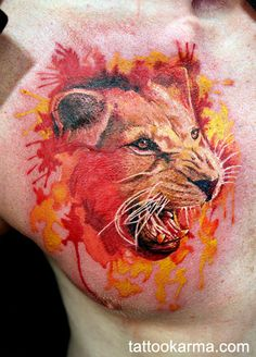 Watercolor Lion I had done yesterday by Mikhail Andersson at InkFest. Couldn't be happier