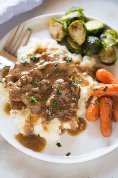 A plate filled with slow cooker pot roast served on top of cream mashed potatoes, with a side of cooked carrots and Brussels sprouts. Pot Roast Recipes, Slow Cooker Recipes, Crockpot Recipes, Cooking Recipes, Game Recipes, Roast Brisket, Beef Tenderloin, Pork Roast, Roast Chicken And Gravy