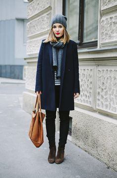 Keeping it simple in a navy coat, brown leather bag and neutral accessories. www.topshelfclothes.com