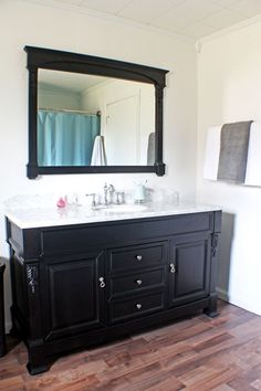 bathroom makeover - NICE, BUT, CHANGE THE WALL COLOR...TOO WHITE AND STARK LOOKING...ADD SOME INTEREST ON SIDES OF CABINET TOP TOO...
