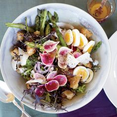 This crispy bread salad spotlights fresh spring produce— asparagus, radishes and red onion.