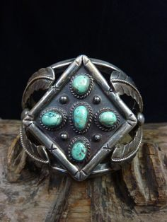 Vintage Navajo Sterling Silver Cuff Bracelet w 5 Fox Turquoise Cabochons and Applied Silver Feathers.